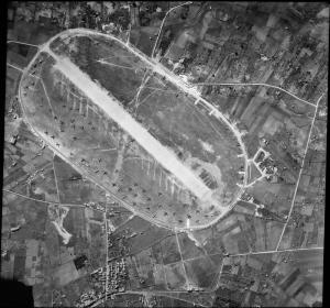 Vertical aerial reconnaissance view of Castelvetrano airfield, Sicily, the day before a successful attack was made on it by Malta-based Bristol Blenheims of Nos. 18 and 107 Squadrons RAF. A number of Junkers Ju 52 and Savoia Marchetti SM 82 transport aircraft, many of which were destroyed during the raid, can be seen parked around the airfield perimeter. © IWM (C 4183)
